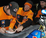 red bull/ktm riders chris blais and andy grider review their notes for the next day